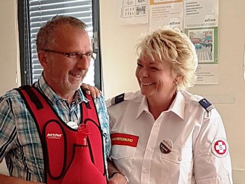 Ein Foto von Hrn. Hofmann und Frau Hofmann-Eisner (Vortragende bei ASSIStMOBI), Arbeiter-Samariter-Bund-Mitarbeiter*innen