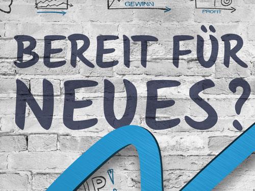 """Symbolbild: Ziegelsteinmauer mit Schriftszug """"Bereit für Neues?"""""""