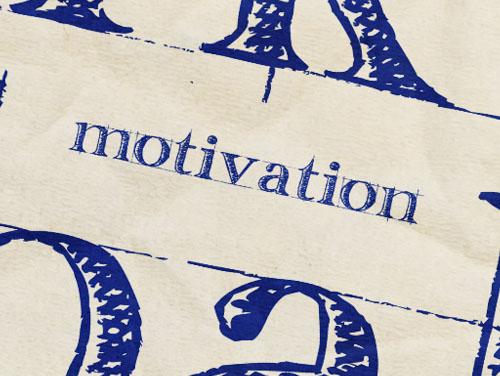 """Das Wort """"Motivation"""" auf Papier gedruckt, Symbol für Bildungsabschlüsse."""
